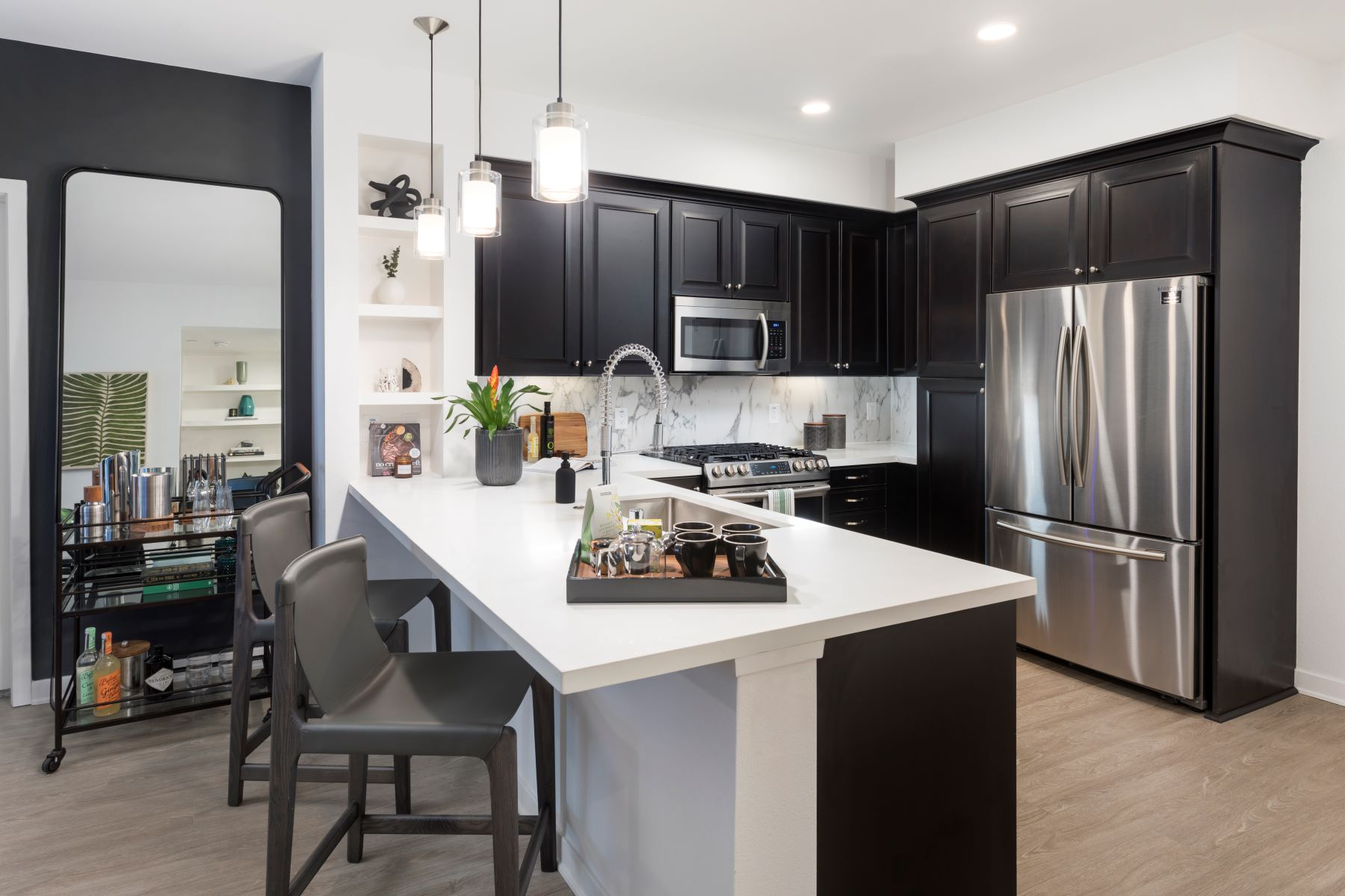 designer kitchen with stainless steel appliances at broadstone arden
