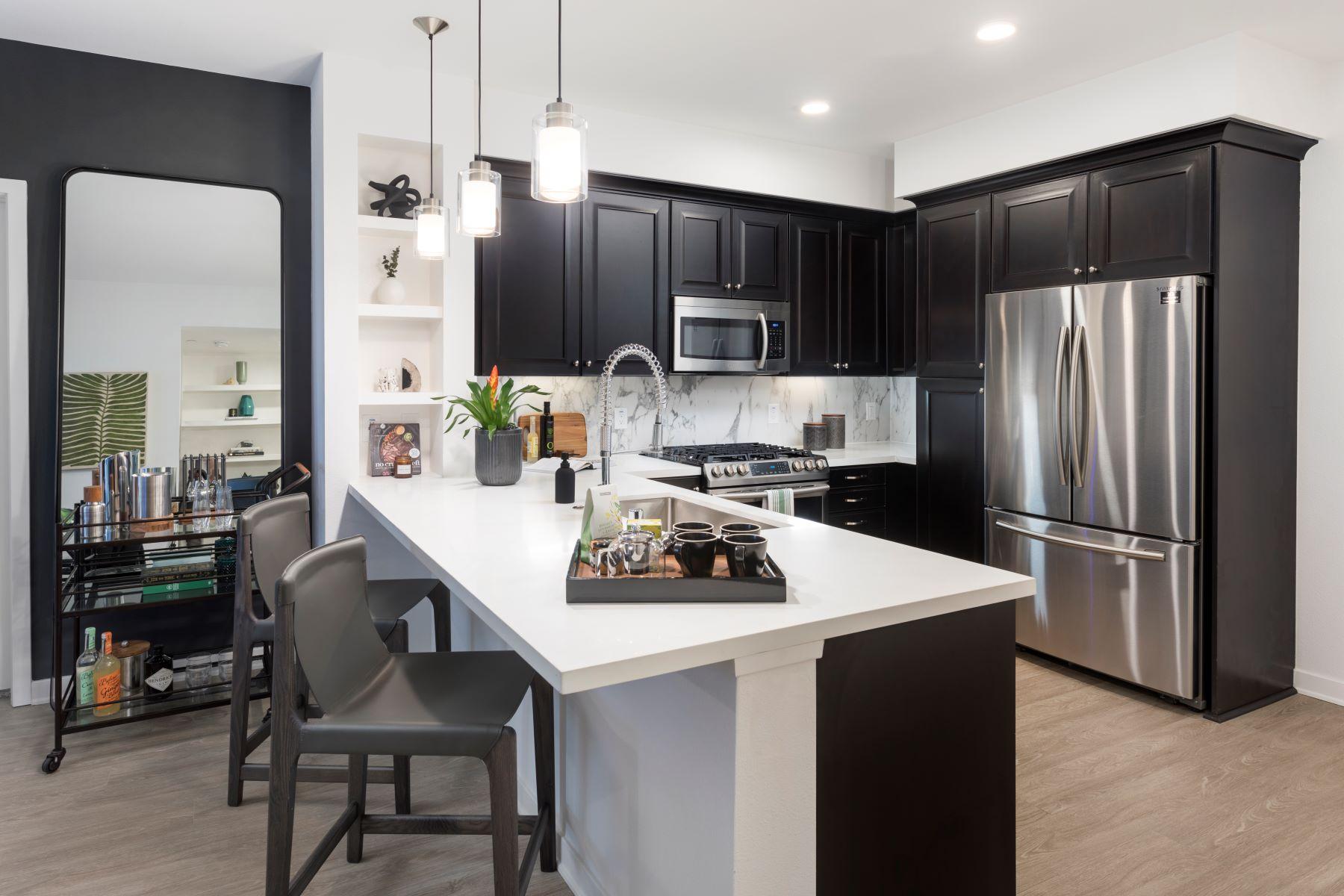 designer kitchen with stainless steel appliances at broadstone arden
